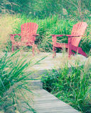 Patio chairs and grass Stock Photo