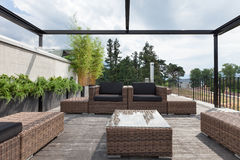 Patio with comfortable garden furniture Royalty Free Stock Photo