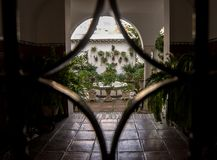 Patio of Cordoba from the entrance iron door royalty free stock images
