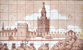 Patio de Banderas and the Giralda Tower, Seville, Andalusia, Spain. Glazed tiles of the yard of flags, named  Patio de Banderas, Alcazar of Seville, silhouette Royalty Free Stock Photos