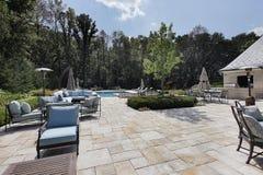Patio de piedra grande con la piscina Fotos de archivo libres de regalías