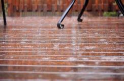 Patio/ deck in heavy rain. Patio/ deck floor during heavy rain. Selective focus royalty free stock photo