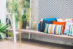 Patio deck. Patio outdoor deck with colorful pillow on chair decoration exterior of home - Vintage light filter stock photos