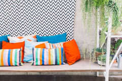 Patio deck. Patio outdoor deck with colorful pillow on chair decoration exterior of home - Vintage light filter stock image