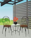 Patio del patio con el sistema de los bistros Foto de archivo libre de regalías