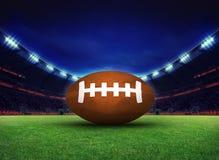 Patio del estadio del rugbi con la bola Imagenes de archivo