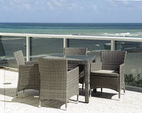 Patio dinning set overlooking the sea Royalty Free Stock Photos