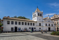 Patio do Colegio Sao Paulo Brazil. The mark zero of the foundation of the city of Sao Paulo, the white historical building chapel with a cross and a tower Royalty Free Stock Photos
