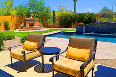 Patio. Entertainment area on patio with furniture, pool and fireplace Royalty Free Stock Photo