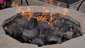Patio Fire Pit. A Patio Fire Pit creating a warm and cozy atmosphere Royalty Free Stock Images