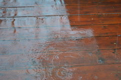 Patio floor wet by rain. Rainy day. Terrace. Patio flooded by rain. Water drops. Outdoor Royalty Free Stock Photo