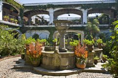 Patio with fountain. Romantic patio with fountain in an colonial styled house in guatemala Royalty Free Stock Photos