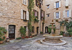 Patio with fountain in the old village Tourrettes-sur-Loup Stock Photo