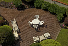 Patio Furniture. A view of Summer patio furniture and a wooden deck Royalty Free Stock Photography