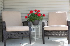 Patio furniture. And red geranium Royalty Free Stock Image