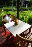 Patio furniture of a balinese garden royalty free stock photo