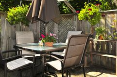 Patio furniture on a deck stock photography