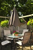 Patio furniture on a deck. Wooden deck of a house with patio furniture royalty free stock image
