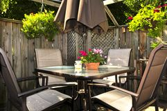 Patio furniture on a deck stock images