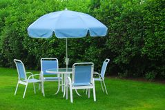 Patio furniture on lawn stock images