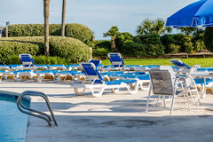 Patio Furniture Between Pool and Ocean Stock Photography
