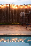 Patio furniture in rain. Patio furniture during rain storm cancel spring party Stock Photos