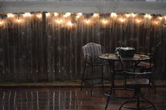 Patio furniture in rain. Patio furniture during rain storm cancel spring party Royalty Free Stock Photo