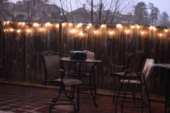 Patio furniture in rain. Patio furniture during rain storm cancel spring party Stock Photo