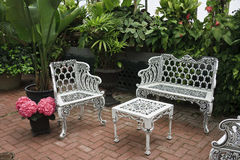 Patio Furniture. White, wrought iron patio furniture and flowers Royalty Free Stock Image