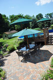Patio and Garden. View of the patio and garden with pool Royalty Free Stock Photography