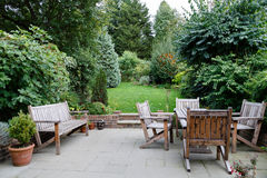 Patio garden furniture. Backyard, patio and garden furniture in an English home Royalty Free Stock Images