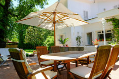 Patio garden furniture. Backyard, patio and garden furniture in an Italian home Stock Images