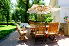 Patio garden furniture. Backyard, patio and garden furniture in an Italian home Stock Photos
