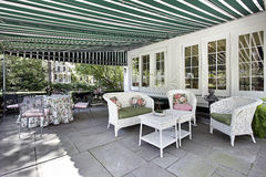 Patio with green awning. Patio in luxury home with green awning royalty free stock photos