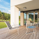 Patio in modern villa. Simple outdoor furniture set on patio in modern villa Royalty Free Stock Images