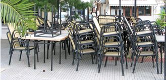 Patio not Opened Yet. A pile of chairs in a patio that is closed royalty free stock photos