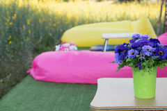 Patio outdoor deck with colorful pillow and flower decoration on Royalty Free Stock Photos