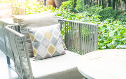 Patio outdoor deck with pillow on chair decoration exterior of h. Ome - Vintage light filter stock photo
