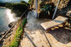 Patio overlooking the sea. Deck chair in the patio of a house overlooking the sea royalty free stock photos