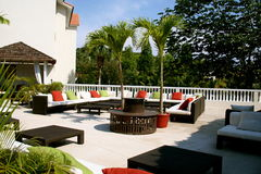 Patio and palm trees Royalty Free Stock Images
