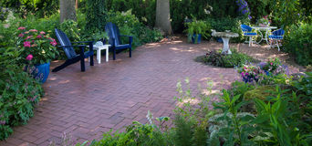 Patio Panorama. Panorama of a secluded patio retreat ready for close friends, relaxation, and conversation Royalty Free Stock Image