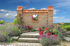 Patio with planted brickwal. L - lavender flowers and roses stock photos