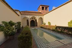 Patio with pool in Alcazaba moorish castle in Malaga. Patio with pool and archs in Alcazaba moorish castle in Malaga, Spain Stock Photo