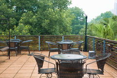 Patio rattan chairs and table  in raining Royalty Free Stock Photography