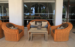 Patio with rattan sofa and armchairs Stock Image