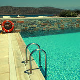 Patio and resort pool overlooking the Mediterranean sea Stock Photography