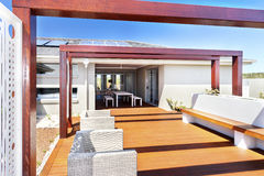 Patio seating area of a modern house and wooden floor Stock Photography