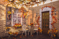 Free Patio. Shutters Of The Window And Brick Walls Decorated With Aut Stock Photography - 76334132