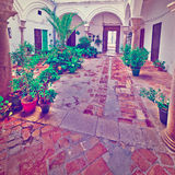 Patio. In the Spanish House Decorated with Flowers, Vintage Style Toned Picture Stock Photos