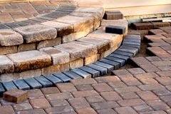 Patio Steps Side View. Pavers meets with patio steps and job completion almost done, steps have rain slope royalty free stock photography